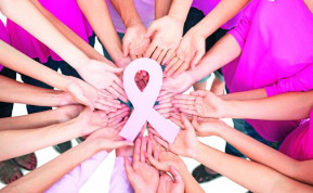 Hands joined in circle holding breast cancer struggle symbol 25094534